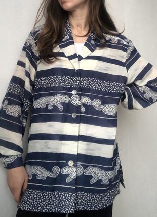 Симпатичная удлиненная блуза прямого кроя с леопардиками2 фото