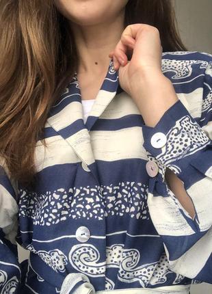 Симпатичная удлиненная блуза прямого кроя с леопардиками4 фото