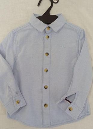 Рубашечка нежно голубая плотная фирмы rebel на 2 года