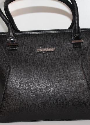 Елегантна жіноча сумка