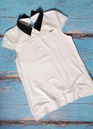 Трикотажна блузка з мереживними рукавами