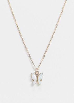 Золотистая цепочка с подвеской в форме бабочки с голубым камнем