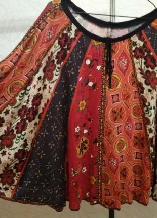 Очень красивая блуза  из трикотажа versace