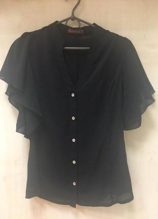Воздушная блуза с воланами