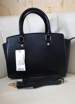 Новая шикарная сумочка  под сафьян цена на бирке 800 грн.