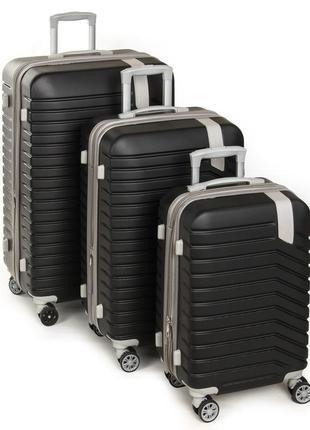 Комплект из трех пластиковых чемоданов, выполненный из ударопрочного abs пласт