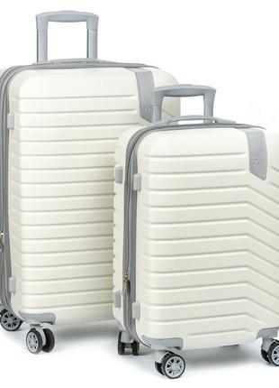 Стильный комплект из двух чемоданов,выполненный из ударопрочного abs пластика.