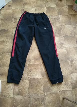 Спортивные штаны фирмы nike club woven warm up semi cuffed 329344-648.оригинал.s-ка.