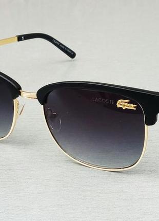 Lacoste очки унисекс солнцезащитные черные с золотом