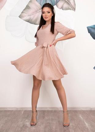 Платье  в горошек с расклешенным низом