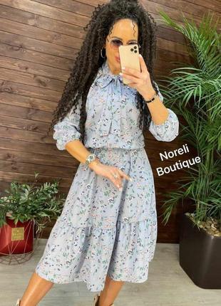 Красивое женское платье миди