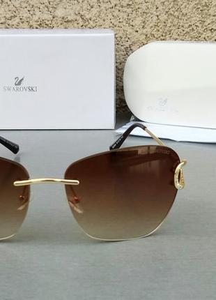 Swarovski очки женские солнцезащитные коричневые безоправные с градиентом