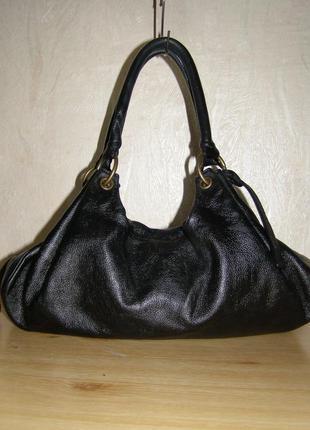 Удобная сумочка от бренда clarks, нат.кожа