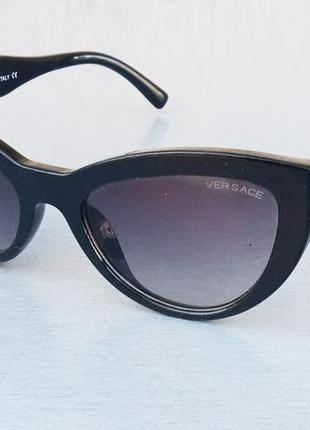 Versace стильные женские солнцезащитные очки черные с золотом