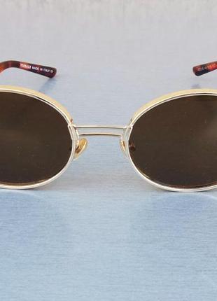 Versace стильные солнцезащитные очки унисекс овальные коричневые в золоте