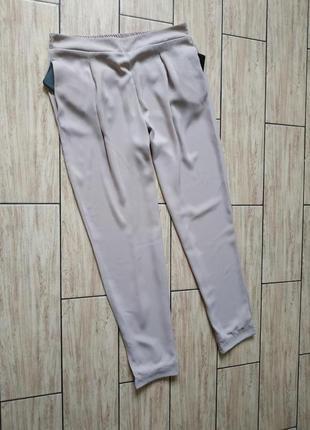 Нюдовые штаны зауженные с боковыми карманами