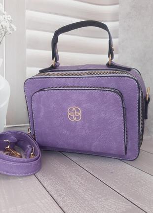 Яркая каркасная сумочка