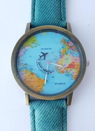 Часы с картой мира и летящим самолётом. кварц.