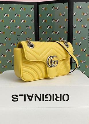 Кожаная женская сумка жёлтого цвета на лето