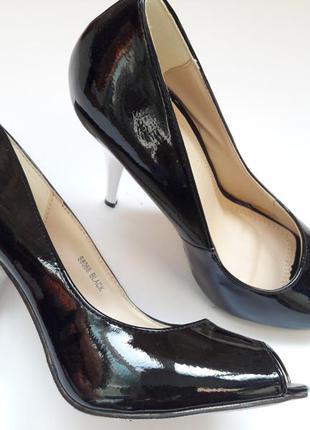 Черные туфли на серебряном каблуке до 20.01 цена 300 грн