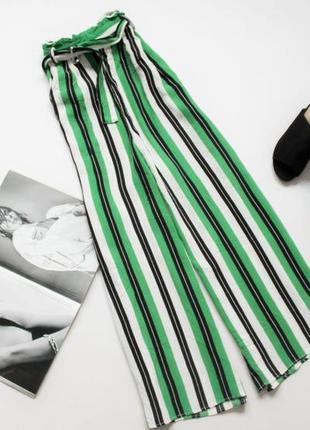 Красивые широкие брюки палаццо зеленые