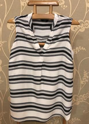 Очень красивая и стильная брендовая блузка в полоску...100% вискоза.