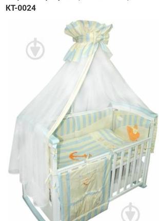 Комплект постельного белья для кроватки.