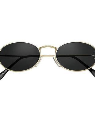Круглые очки с золотой оправой