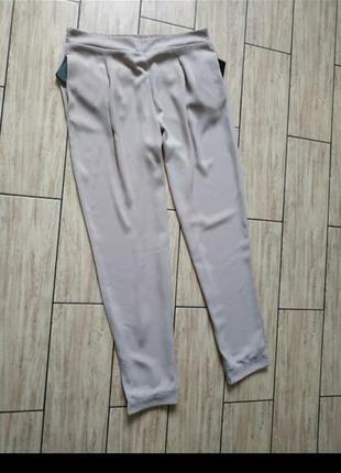 Стильные нюдовые брюки штаны с боковыми карманами