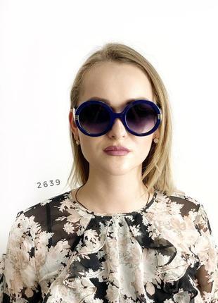Круглі сонцезахисні окуляри чорні у синій оправі к. 2639
