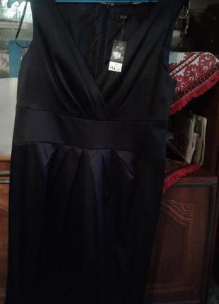 Стильне фірмове (новеньке з біркою)чорне плаття ,яке має бути в гардеробі кожної жінки.