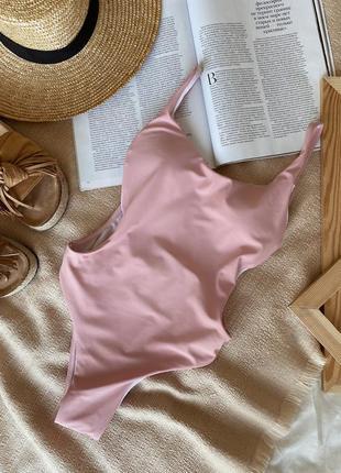 Купальник сдельный с разрезами по бокам  розовый