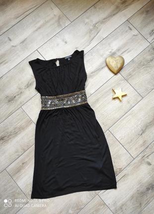 Трикотажное платье в греческом стиле