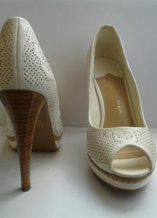 Кожаные туфельки с открытым носком lino marano