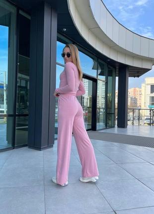 Спортивний костюм рожевого кольору у рубчик