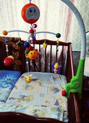 Музыкальные игрушки на кроватку