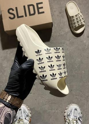 Adidas yeezy slide logo