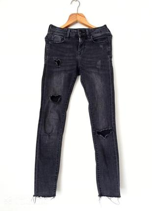 Стильные рваные джинсы скинни с потертостями