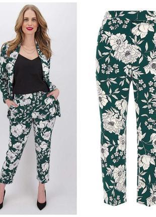 Модные зеленые яркие брюки с эффектным цветочным принтом бренда cаpsule.новые с биркой.