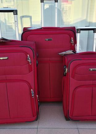 Дорожный чемодан фирмы fly 8279 bordo на двух колесах