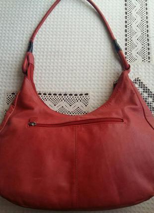 Кожаная сумка(натуральная кожа)нежного красно-лососевого цвета с перфорацией.2