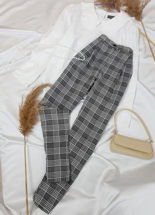 Стильні брюки в актуальну клітинку з защипами на високій посадці від  h&m  .3 фото