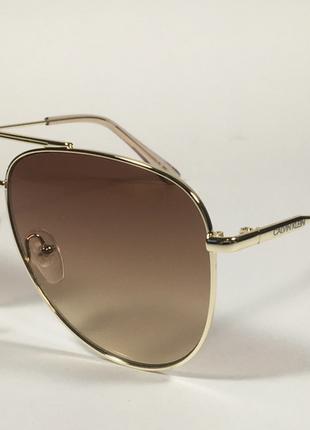 Солнцезащитные очки calvin klein .оригинал  unisex1 фото