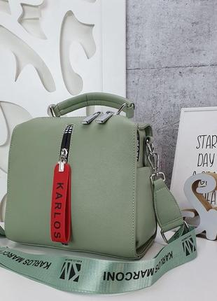 Красивая зелёная сумка с широким тканевым ремешком