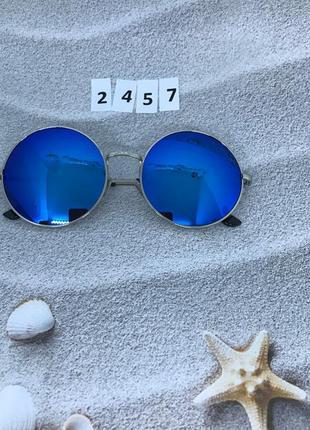 Круглые синие очки в серебрянной оправе