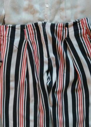 Укороченные брюки в полоску2 фото