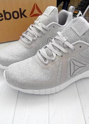 Продам стильные кроссовки универсального серого цвета