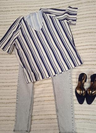 Блузка в синюю полоску, новая.