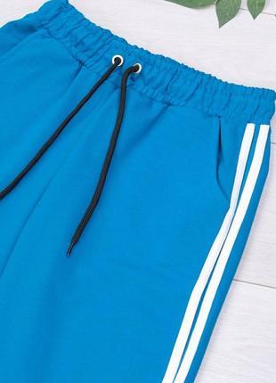 Женские голубые спортивные брюки штаны на высокой посадке резинках с карманами лампасами4 фото