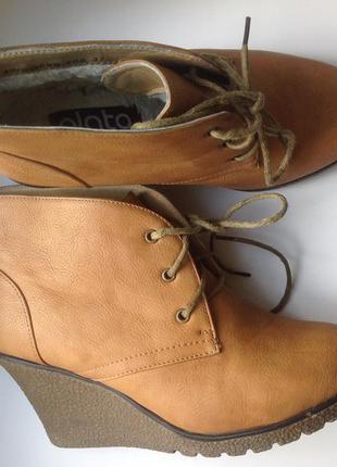 Зимние ботинки на небольшой платформе